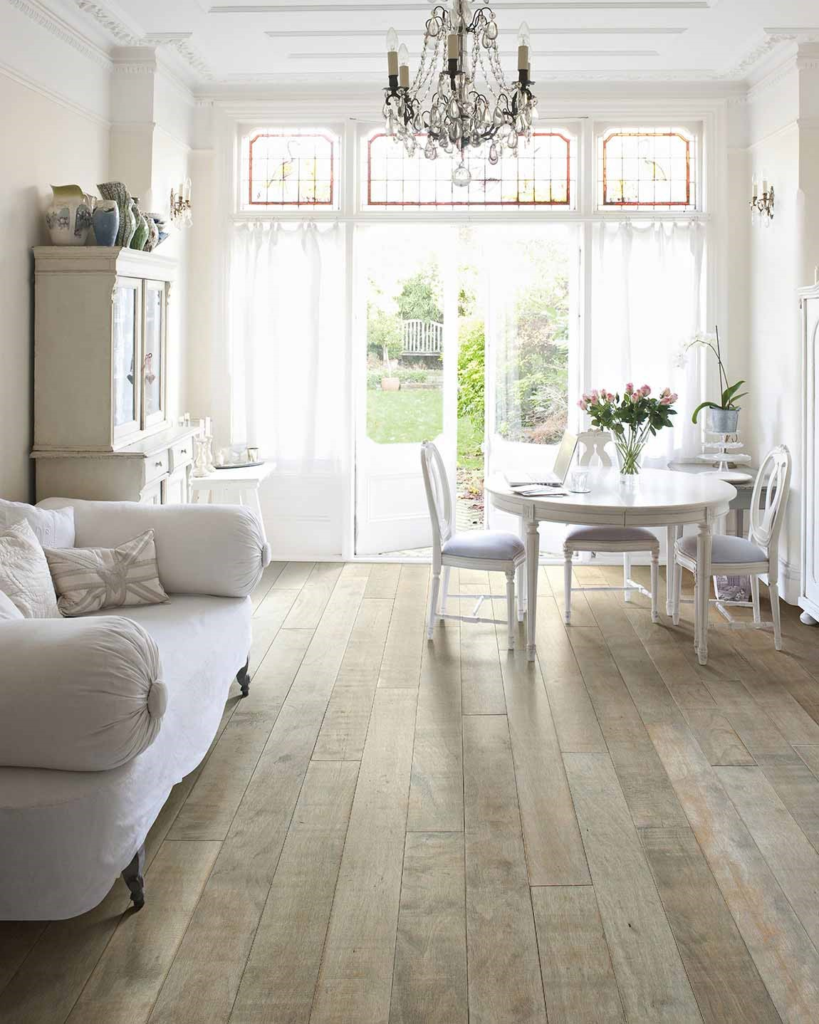 bright living room with white furniture light hardwood floors